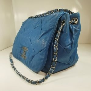 CHANEL Bags - CHANEL BLUE IRIDESCENT PLEATED LEATHER FLAP BAG